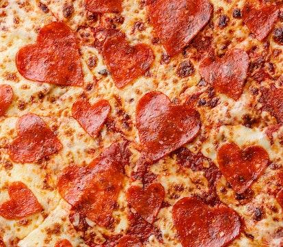 Heart shape Pepperoni Pizza close up background