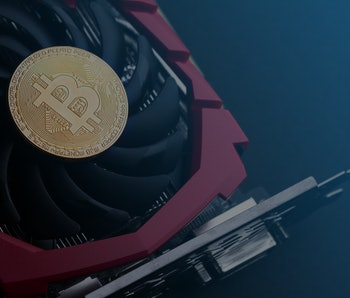cryptocurrency mining concept with one golden bitcoin on top of a computer performant video card bla...