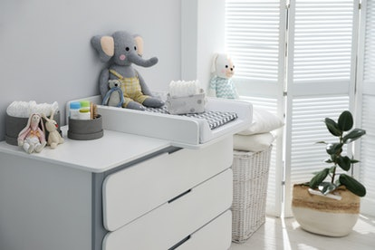 modern changing station in baby room nursery
