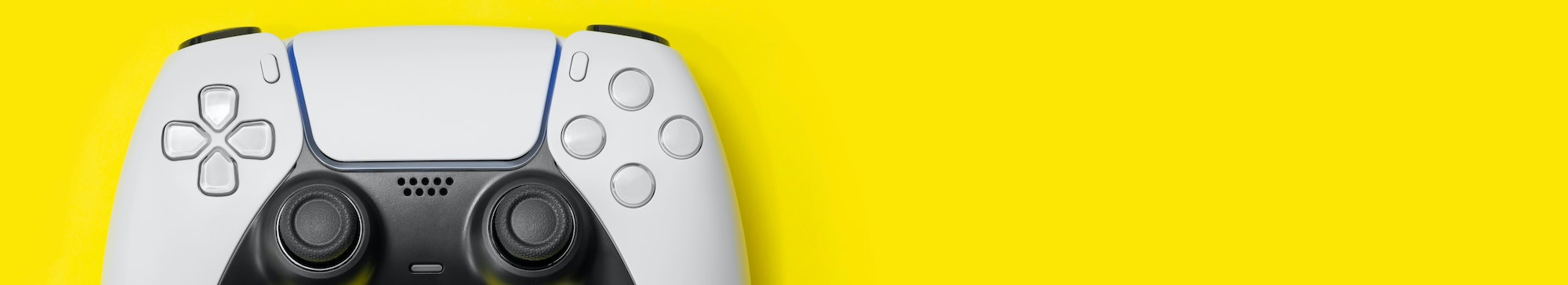 Next Gen game controller on yellow background