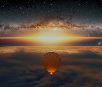 "Hot air balloon flying over sunrise clouds with earth planet sunrise milky way galaxy in the background ""Elements of this image furnished by NASA"