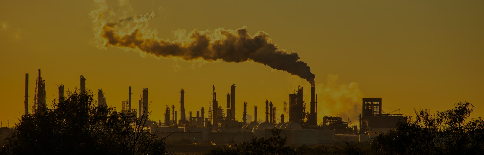smoke stacks emmitting carbon pollution into the sky causing climate change