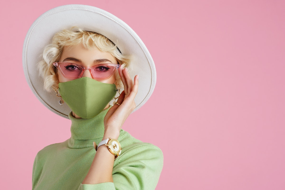 Woman wearing trendy fashion outfit during quarantine of coronavirus outbreak. Model dressed protect...