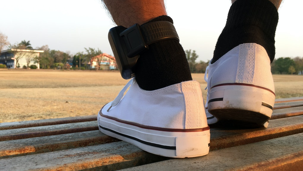 Male prisoners attached to an Electronic Monitoring (EM) ankle were approved for release from prison. Put on white shoes Come exercise out doors.