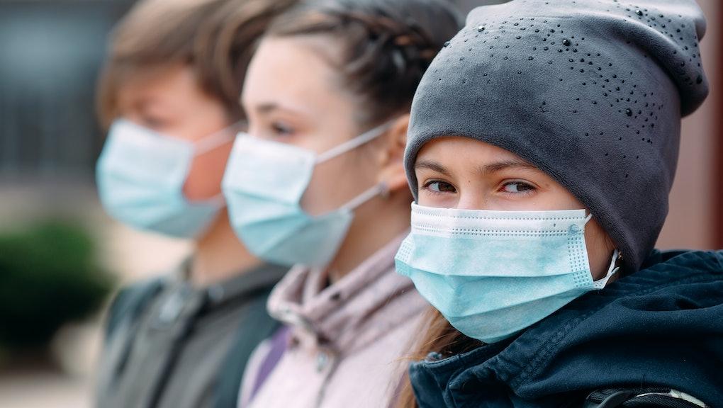 School-age children in medical masks. portrait of school children