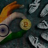 Bitcoin cryptocurrency India flag Golden Coin of Bitcoin in the Indian flag hand giving coin in to hands of poor people Grunge background with binary code of matrix effect