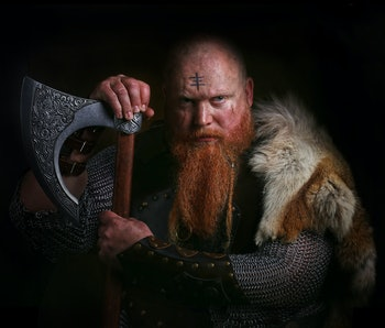 Portrait of viking holding axe shutterstock
