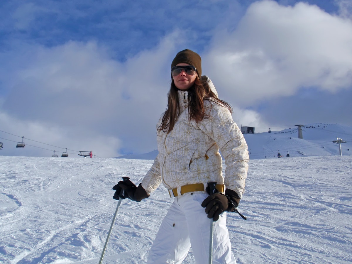 Young woman on ski vacation in the Alps.