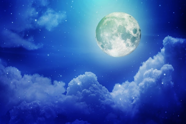 Full moon with night sky in the clouds ,Elements of this image furnished by NASA.