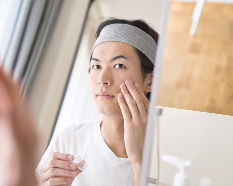 Beauty concept of a young asian man. Skin care.