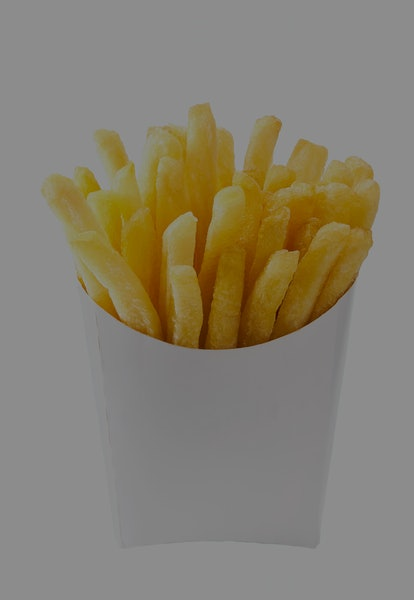 French fries in a white paper box isolated on white background. Front view. french fries in a paper wrapper .