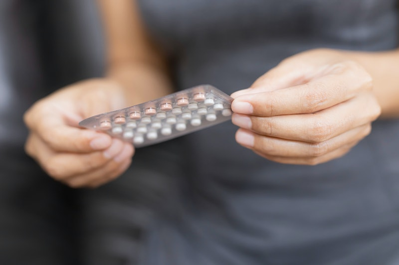 Woman holding combined oral contraceptive pill.Gynecology concept.