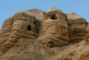 Qumran caves in Qumran National Park near the Dead Sea Israel where the Dead Sea Scrolls discovered between 1946 and 1956.Qumran caves in Qumran National Park Israel. No people. Copy space