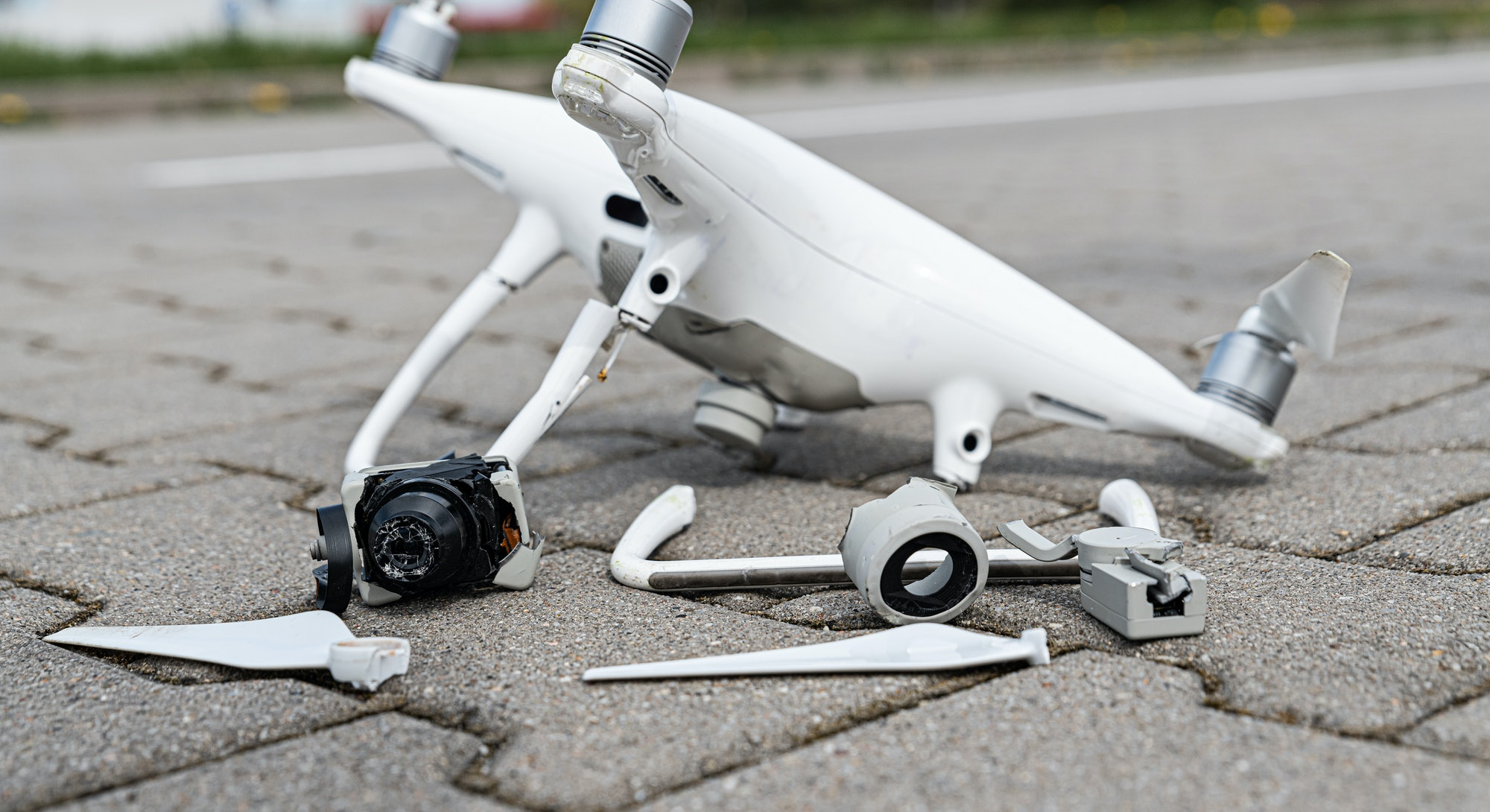 Crashed modern drone and camera after drone accident