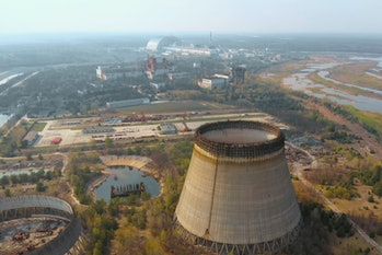 Chernobyl nuclear power plant. Cooling tower overlooking the nuclear power plant in Chernobyl. View of the destroyed nuclear power plant. Chernobyl nuclear power plant, aerial view. Chernobyl NPP