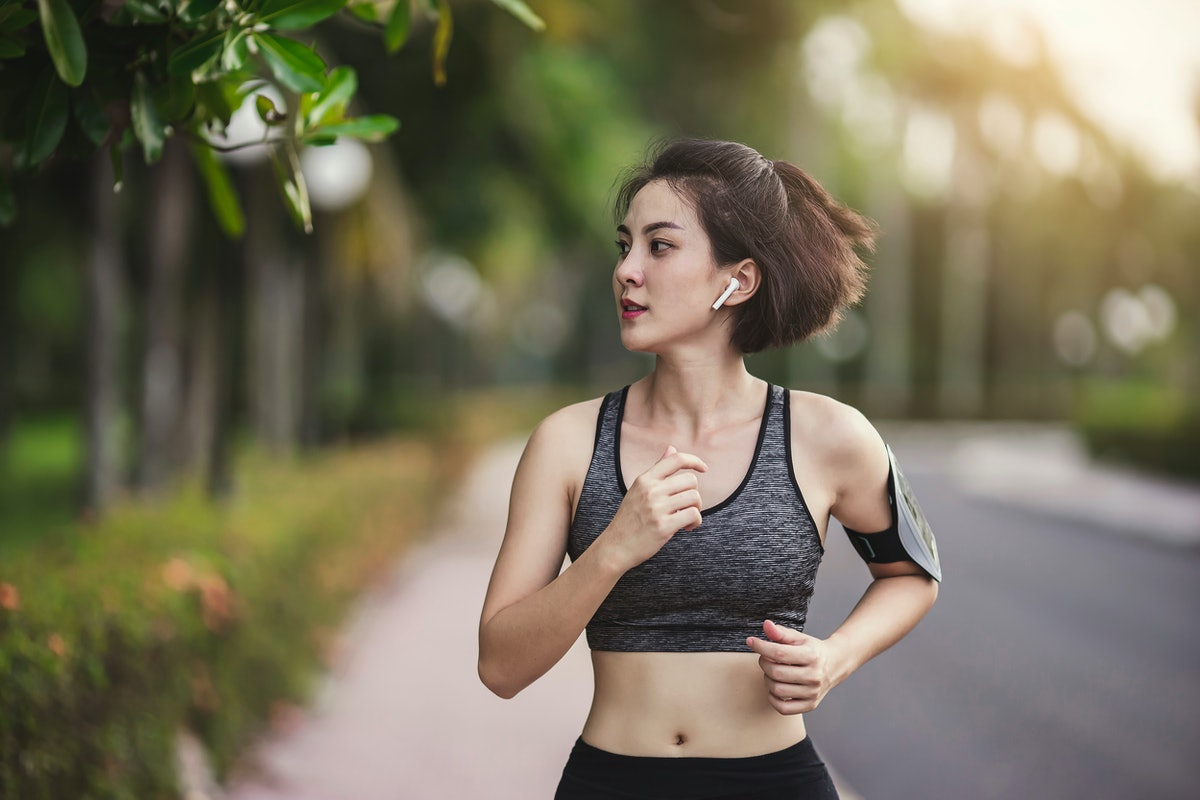 Portrait asian woman healthy jogging exercise in park outdoor, Woman exercise lifestyle.