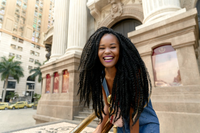 Stunning Black Girl Candid Huge Magic Smile in a Cinematic Warm Urban Scenery Scenery