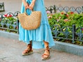 Close up fashion street details of tender stylish woman posing at Europe city, wearing blue maxi dre...