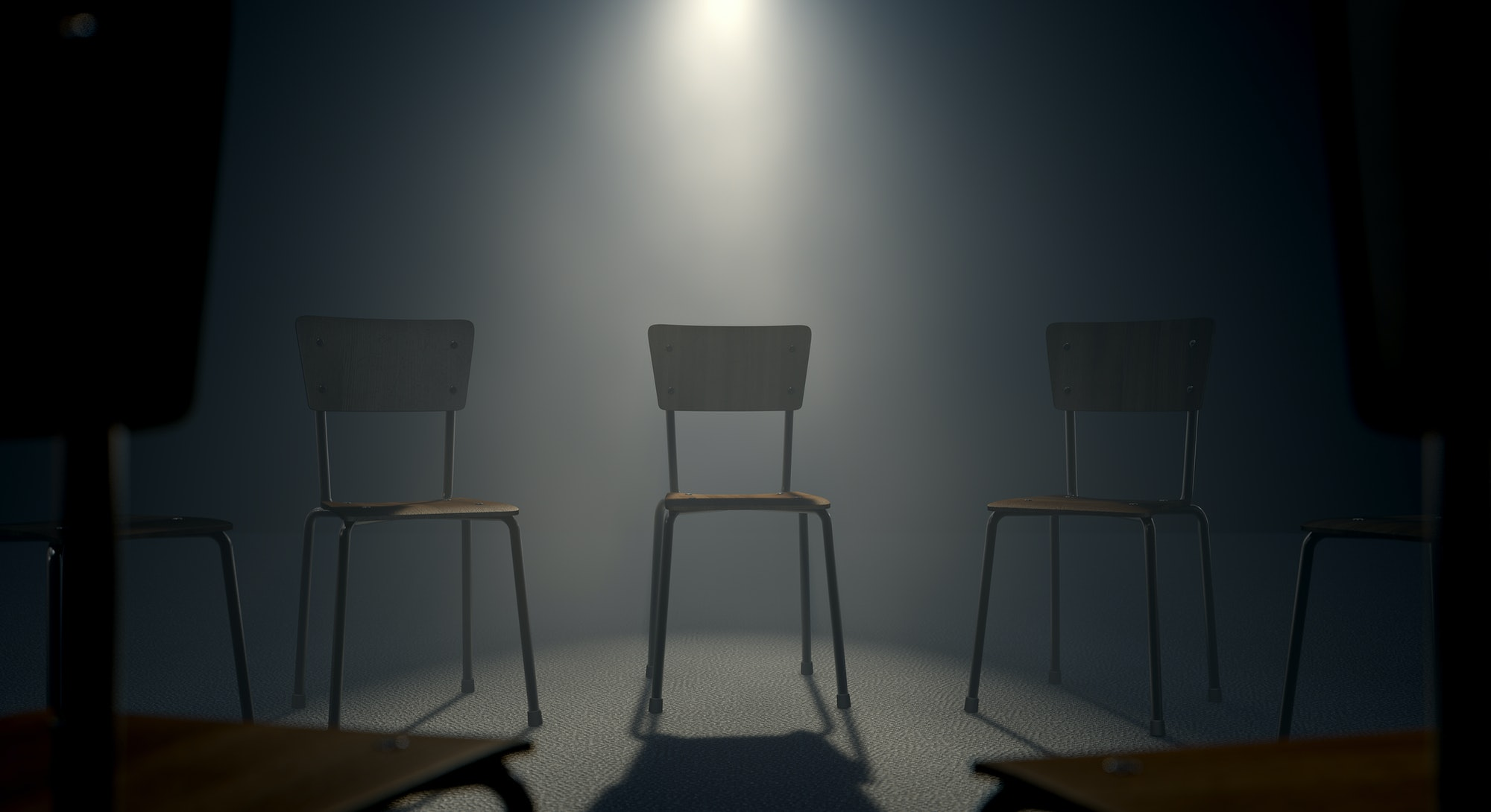 A 3D render concept of a group of chairs in a circular formation with one chair highlighted by a single moody spotlight on a dark background