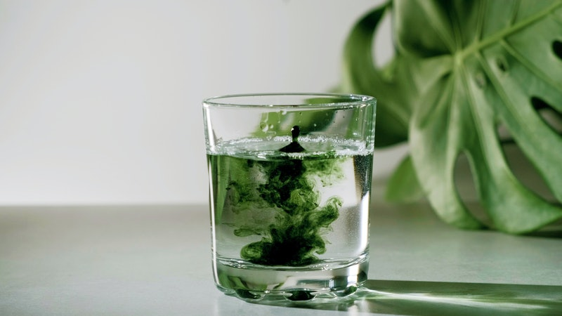 People on TikTok are saying that drinking chlorophyll is clearing their acne. Bustle asked experts t...