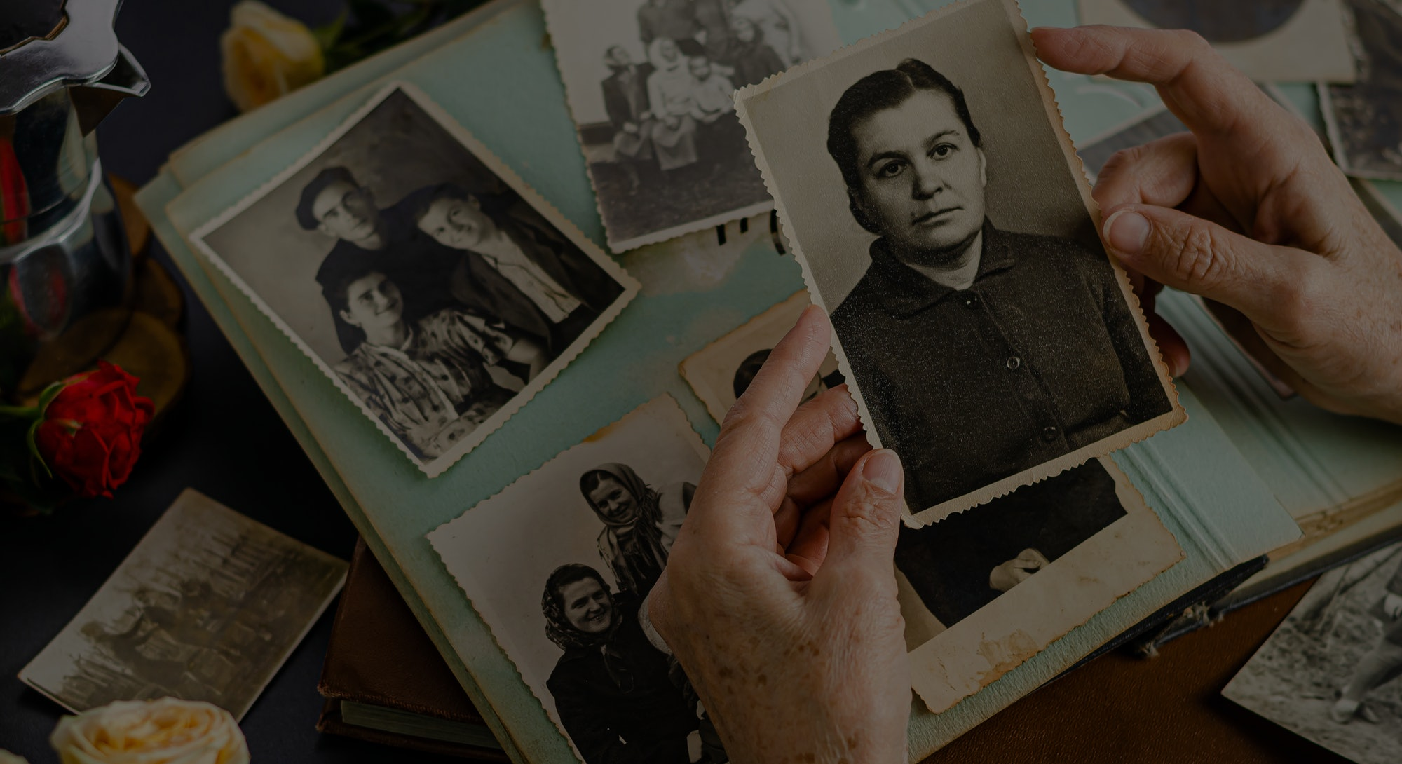 Old photos in a photo album. Picture backup iCloud photos archive.