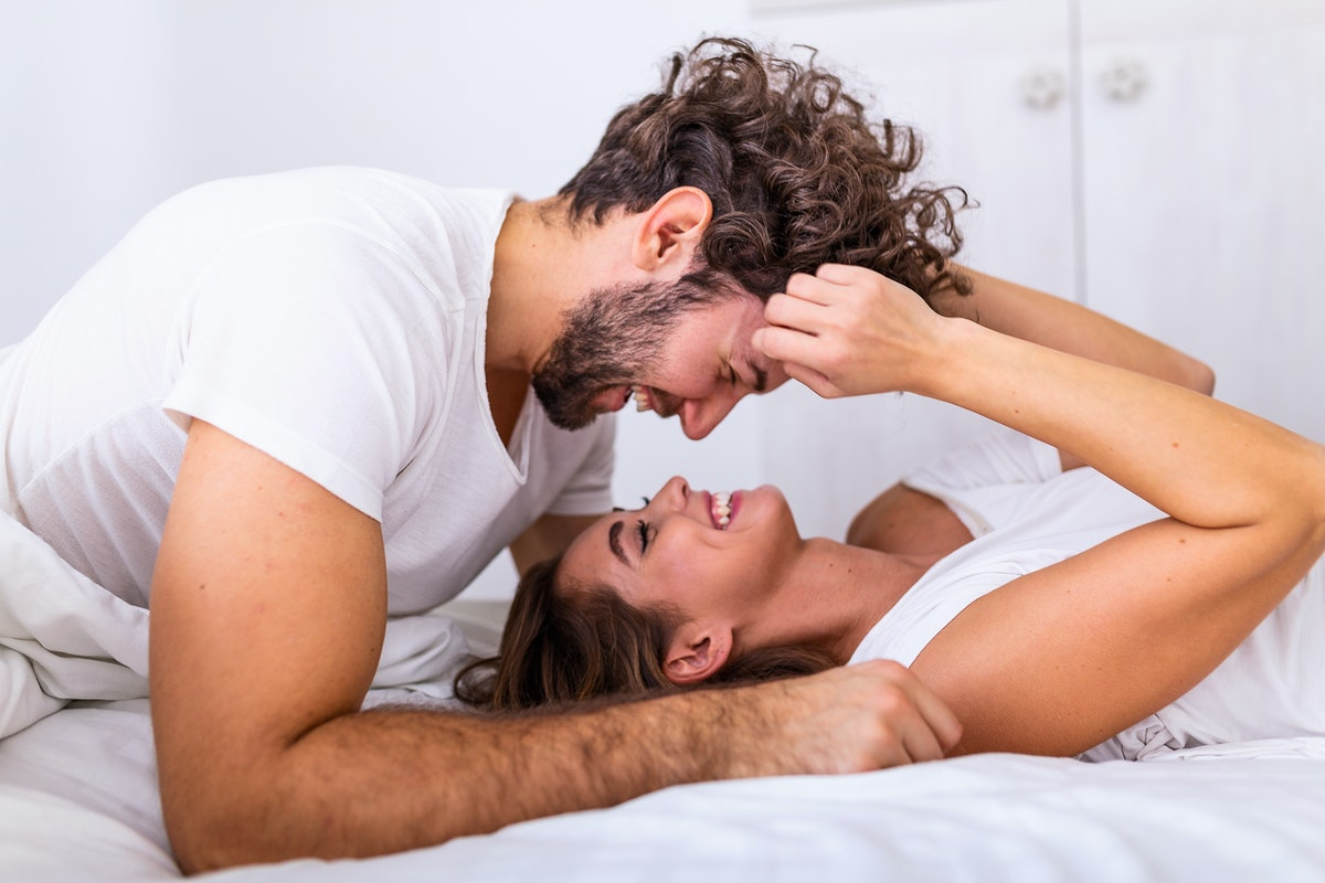 A couple listening to their sex playlist in bed.