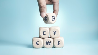Bitcoin Concept, Bitcoin transfer, Hand of business man choose and turn dollar to bitcoin, wood cube...