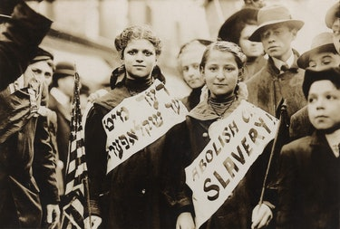 New York City May Day celebration of the international labor day. Two girls in the parade combined c...