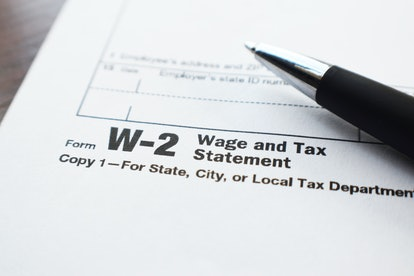 Tax Form W-2 Close Up With Pen