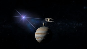 great conjunction of planet jupiter and saturn with the 4 moons of jupiter: io ,europa, callisto ,and ganymede  3d rendering illustration