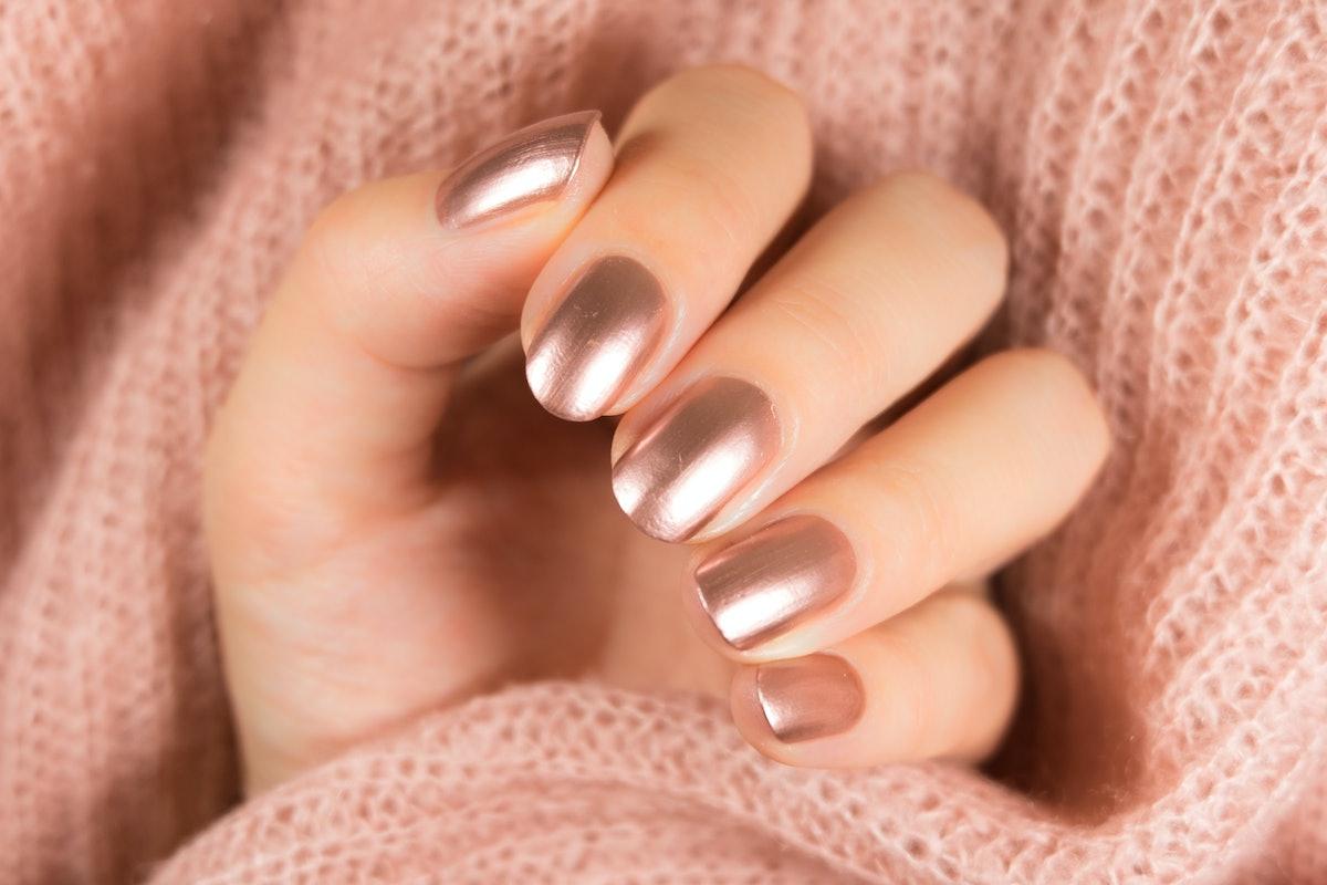 Golden manicure.