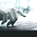 Robot concept or robot hand chatbot pressing computer keyboard enter