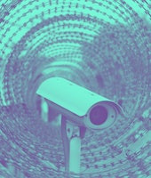 Close up view of security camera hanging among Surveillance Camera And Barbed Wire ,Modern ways of s...