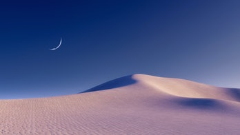 Fantastic unreal sandy desert landscape with massive sand dunes and half moon in clear night sky. Wi...
