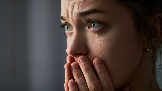 Sad desperate grieving crying woman with folded hands and tears eyes during trouble, life difficulti...