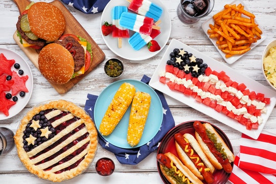 Fourth of July, patriotic, American themed food. Above view table scene on a white wood background.