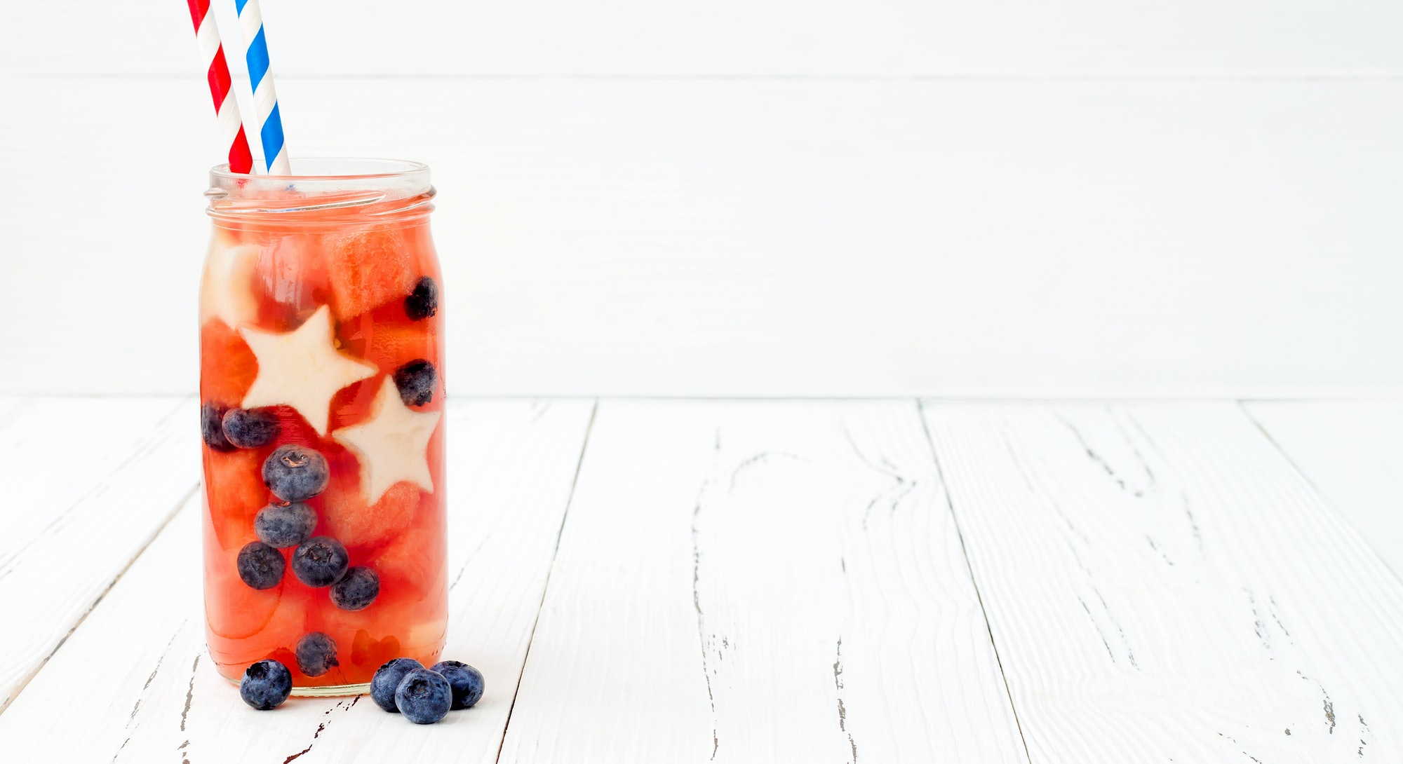 Red, White and Blue lemonade or sangria. Patriotic drink cocktail with watermelon, blueberry and app...