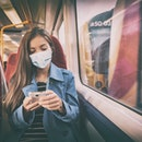 Face mask concept. Woman wearing mandatory mask inside public spaces for transport such as train sta...
