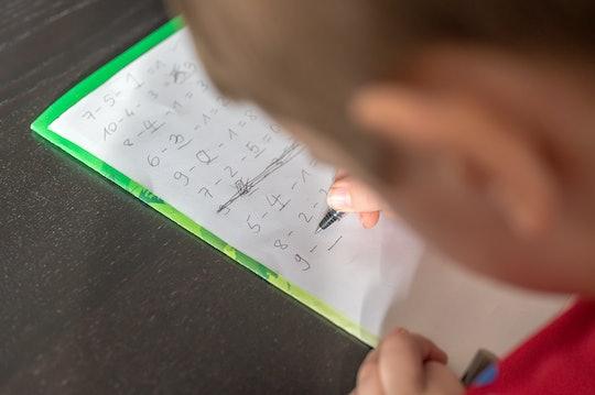 A child practices math problems.