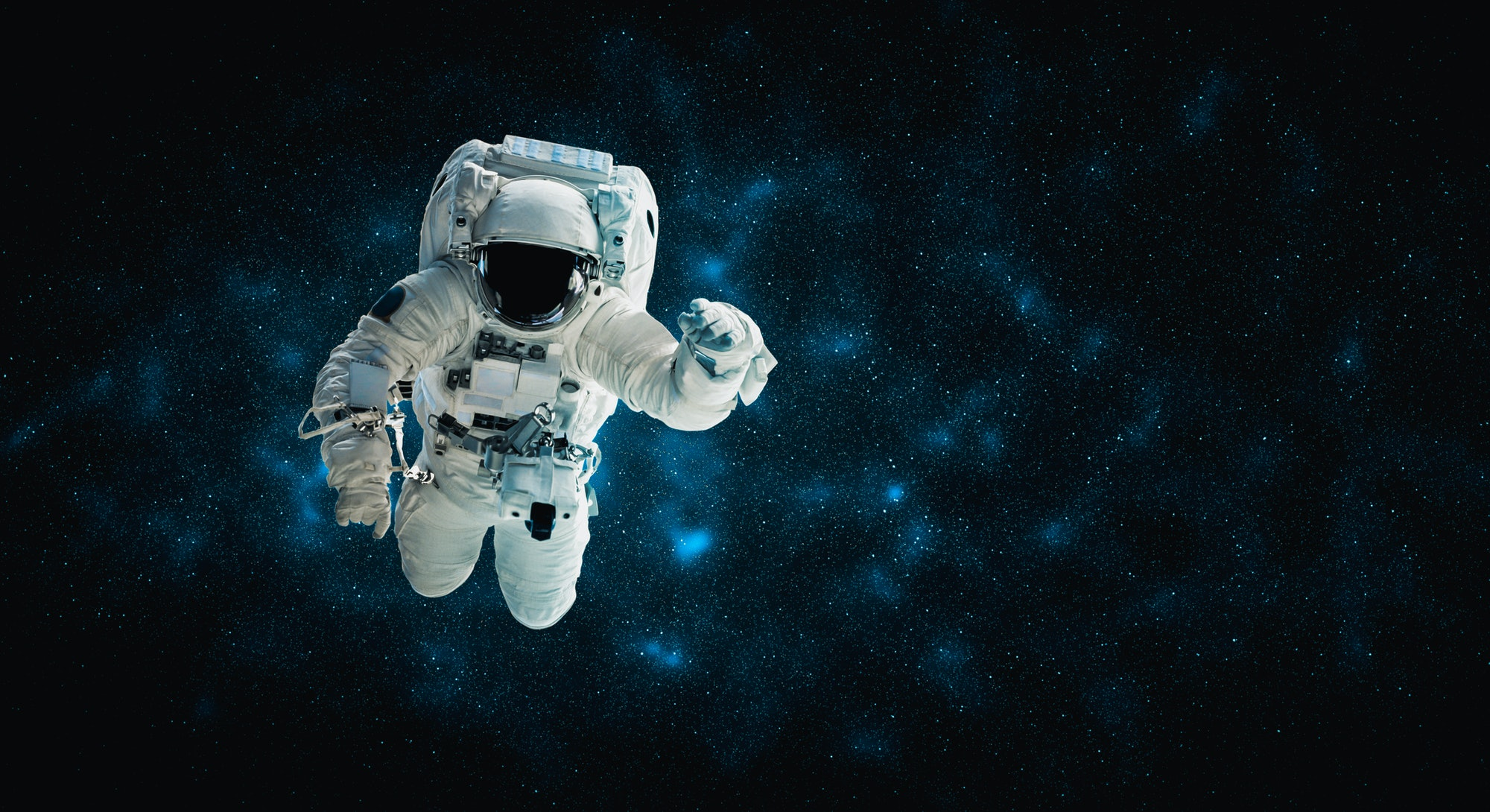 Astronaut spaceman do spacewalk while working for space station in outer space . Astronaut wear full...