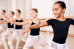 Young ballerinas rehearsing in the ballet class. They perform different choreographic exercises. The...