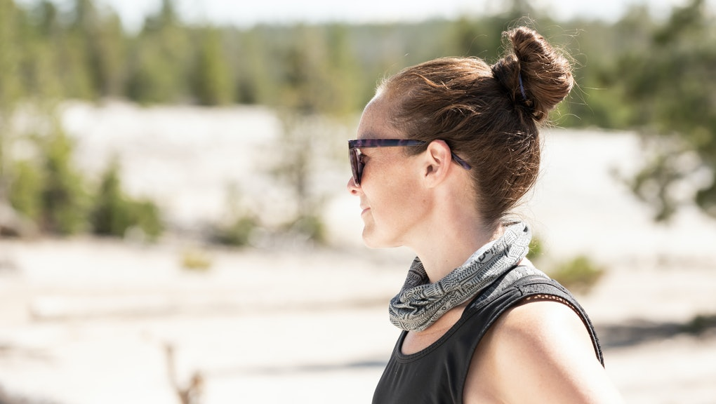 Woman with Sunglasses Looks Out over Yellowstone Geyser Basin