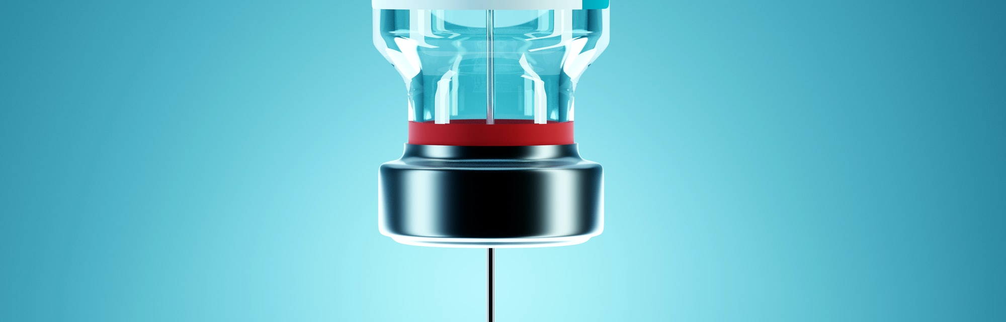 SARS - CoV2 Vaccine concept. A medical needle entering into a glass vial of COVID-19 Vaccine. Medica...