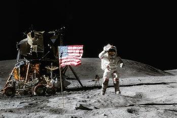 Astronaut on lunar moon landing mission Apollo 11.Astronaut space walk on moon with lunar orbitor sp...