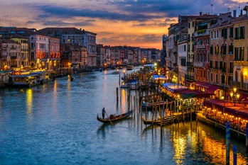 Grand Canal with gondolas in Venice, Italy. Sunset view of Venice Grand Canal. Architecture and land...