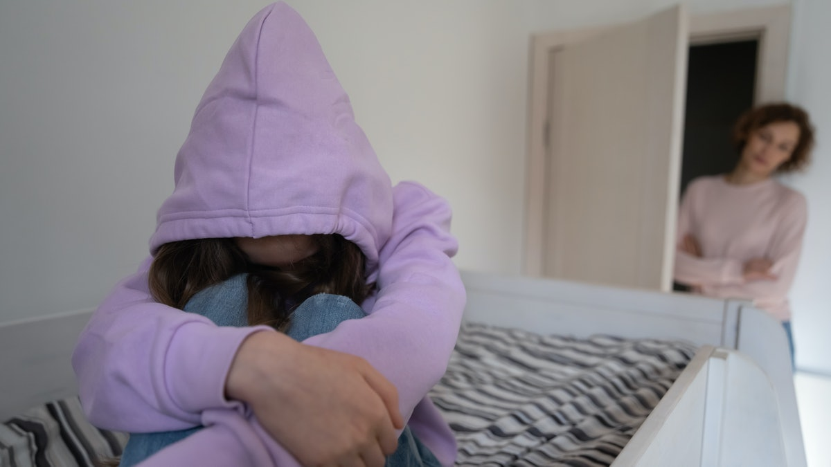 Anxious mom worry about introvert teen daughter hiding in hood, suffer from school discrimination bu...