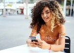 Woman sexting on phone by zodiac sign.