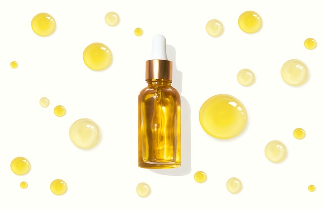 Oil serum glass bottle and collagen drops realistic vector illustration, top view. Aromatherapy oil....