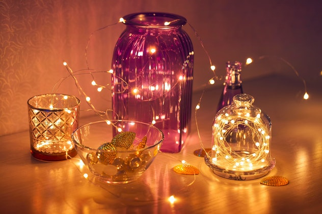 Twinkling lights in the interior; image of strands of small white lights draped in and around glass ...