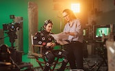 On Film Set: Prominent Female Director Explains Scene to Male Actor Wearing Motion Capture Suit and ...